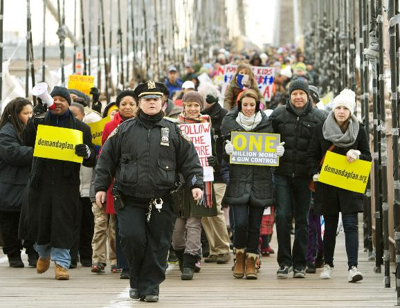 One Million Moms For Gun Control march takes place in New York: Hundreds march across the Brooklyn Bridge as they take part in the