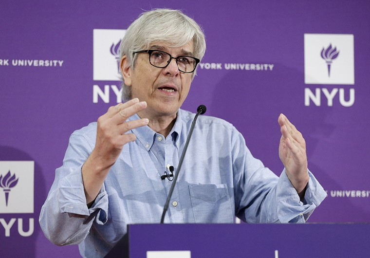 Winner of the 2018 Nobel Prize in Economic Sciences Paul M. Romer walks to the podium to speak at a press conference at NYU in New York City on October 8, 2018. This year's winners of the Nobel Prize for Economics are William Nordhaus and Paul Romer, recognized for taking macroeconomics to a global scale to tackle some of the world's biggest problems.     Photo by John Angelillo/UPI