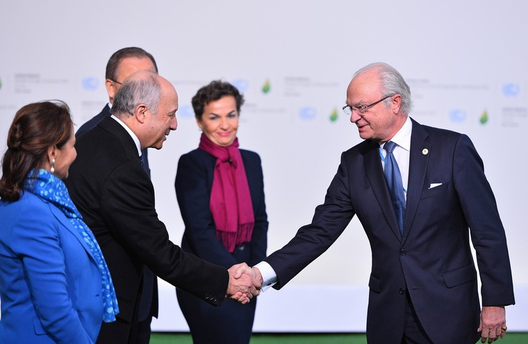 Sweden's King Carl XVI Gustaf (R) shakes hands with French Foreign Affairs Minister Laurent Fabius as French Environment Minister Segolene Royal (L), U.N. Secretary General Ban Ki-moon (C) and Executive Secretary of the U.N. Framework Convention on Climate Change Christiana Figueres look on at the United Nation's 21st climate change conference at Le Bourget near Paris on November 30, 2015. The almost 150 heads of state and representatives from 200 countries in attendance will attempt to negotiate a legally binding agreement to limit worldwide carbon emissions with the goal of keeping global warming under 2 degrees Celsius.   Photo by David Silpa/UPI