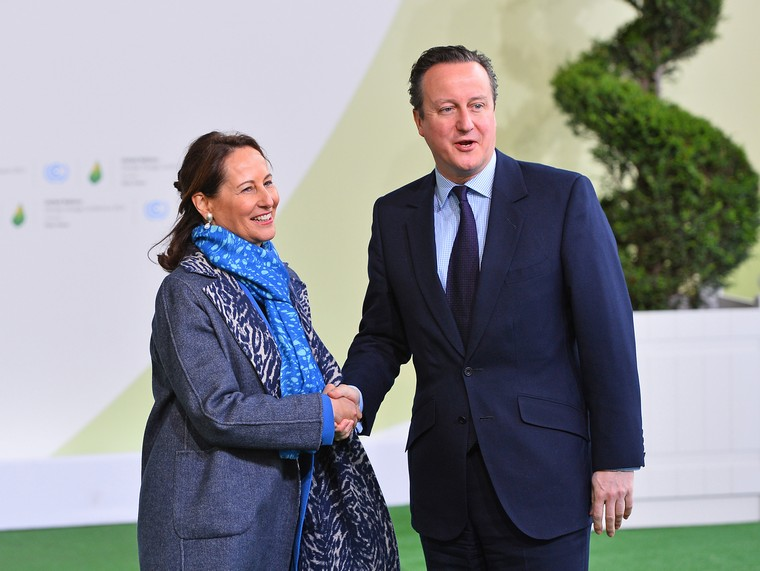 British Prime Minister David Cameron (R) is greeted by French Environment Minister Segolene Royal at the United Nation's 21st climate change conference at Le Bourget near Paris on November 30, 2015. The almost 150 heads of state and representatives from 200 countries in attendance will attempt to negotiate a legally binding agreement to limit worldwide carbon emissions with the goal of keeping global warming under 2 degrees Celsius.   Photo by David Silpa/UPI