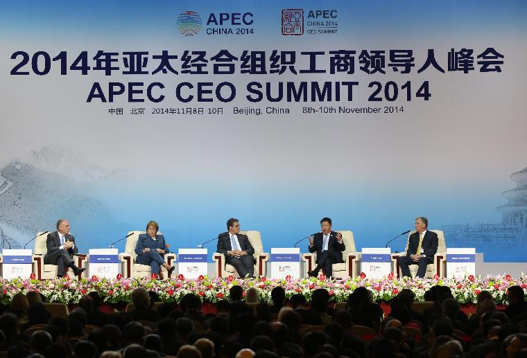 APEC CEO Summit opens in Beijing: (L-R) Dennis Nally, Global Chairman of PricewaterhouseCoopers International Ltd., Chilean President Michelle Bachelet, World Trade Organization (WTO) Director-General Roberto Azevedo, Frank Ning, Chairman of COFCO Corporation & APEC Business Advisory Council Chair 2014, and Caterpillar Chairman and CEO Douglas Oberhelman attend a summit dialogue on Asia-Pacific economic integration and global multilateral trade system during the 2014 Asia-Pacific Economic Cooperation (APEC) CEO Summit in Beijing on November 9, 2014.   Leaders of more than half the world's economy are gathering in China's capital for the annual APEC forum.     UPI/Yin Gang/Pool