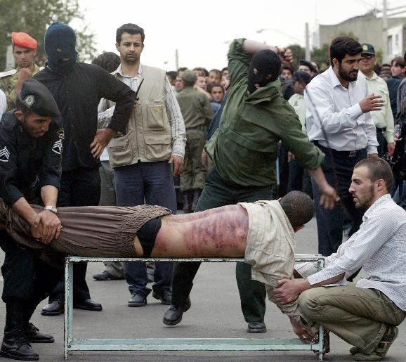 UPI Pictures of the Year 2007: Saeed Ghanbari receives 80 lashes in public view in the Qazvin province, 91 Miles (165 Km) west of Tehran, Iran on August 21, 2007. Ghanbari was convicted of consuming alcohol and having sex outside of marriage. (UPI Photo/Mohammad Kheirkhah)