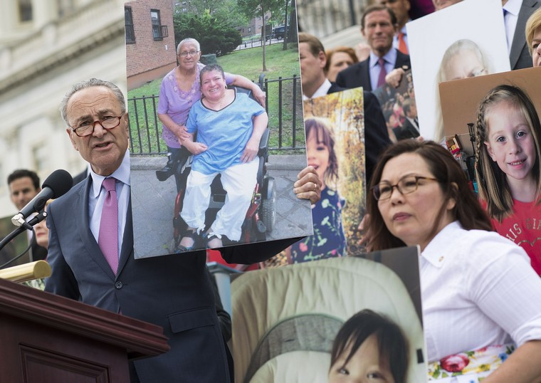 Senate Majority Leader Charles Schumer, D-N.Y. speaks out against the Republican health care bill as he and other Senate Democrats hold photos of people who would lose their health coverage under bill, during a press conference at the U.S. Capitol on June 27, 2017, in Washington, D.C. After lacking votes the Republican leadership has delayed the health care bill vote until after the July 4th recess. Photo by Kevin Dietsch/UPI