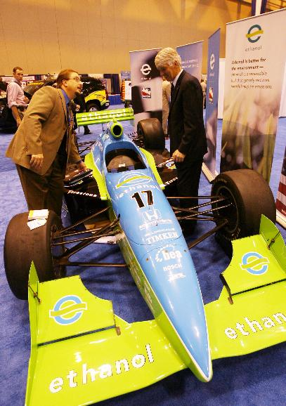 U.S. DEPARTMENT OF ENERGY/U.S. DEPARTMENT OF AGRICULTURE/ ADVANCING RENEWABLE ENERGY NATIONAL CONFERENCE.: Attendees at the Advancing Renewable Energy National Conference look over the 650-horsepower Indy car that will run on 100% fuel-grade ethanol beginning in 2007,  at America's Center in St. Louis on October 11, 2006. The conference sponsored by the U.S. Department's of Energy and Agriculture is bringing together the minds of the private sector, Federal, State and local governments, utility and energy companies to better understand what is necessary to build a foundation that will bring about an era of widley used clean and renewable energy. (UPI Photo/Bill Greenblatt)