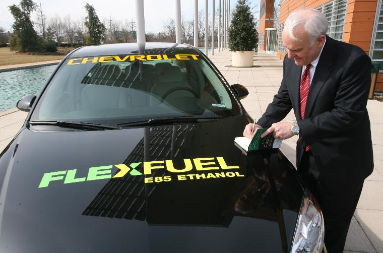 ENTERPRISE RENT-A-CAR GIVES $25 MILLION FOR RENEWABLE FUELS INSTITUTE: Andrew C. Taylor, chairman and CEO of Enterprise Rent-A-Car makes notes in a book on the hood of a car that is using alternative fuels, after announcing his $25 million donation to the Donald Danforth Plant Science Center in Creve Coeur, Missouri on February 26, 2007. The Enterprise donation will be used to speed up the development of plant-based renewable biofuels and decrease the level of greenhouse gases in the atmosphere while reducing dependency on fossil fuels in future years. (UPI Photo/Bill Greenblatt)