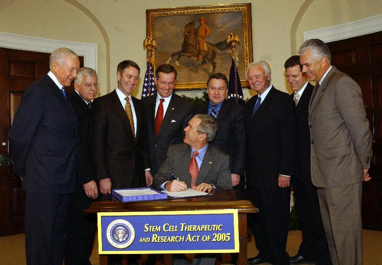BUSH SIGNS STEM CELL RESEARCH ACT--U.S. President George W. Bush signs the Stem Cell Therapeutic and Research Act of 2005 in the Roosevelt Room of the White House on December 20, 2005. With Bush are Sen. Orrin Hatch, R-Ut., Sen. Michael Enzi, R-Wy., Senate Majority Leader Bill Frist, R-Tn., Health and Human Services Secretary Michael Leavitt, Rep. Chris Smith, R-N.J., Rep. Bill Young, R-Fl., Sen. Sam Brownback, R-Ks., and Sen. John Ensign, R-Nv. (L to R)   (UPI Photo/Roger L. Wollenberg)
