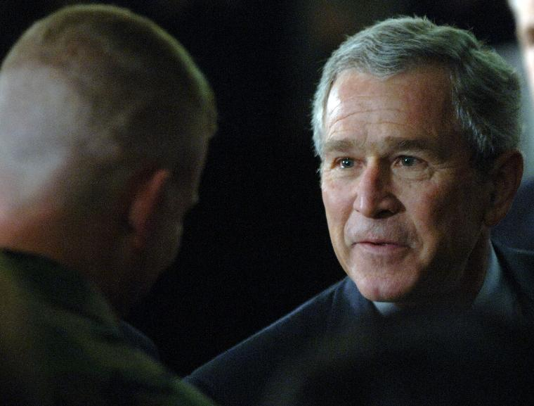 BUSH SPEAKS ON TERRORISM, IRAQ TO VFW: U.S. President George W. Bush greets veterans after speaking to a gathering of Veterans of Foreign Wars (VFW) about the war on terrorism on January 10, 2006, in Washington. Bush continued his public campaign to explain his administration's policies, trying to regain support for the war on terror and the war in Iraq.   (UPI Photo/Roger L. Wollenberg)