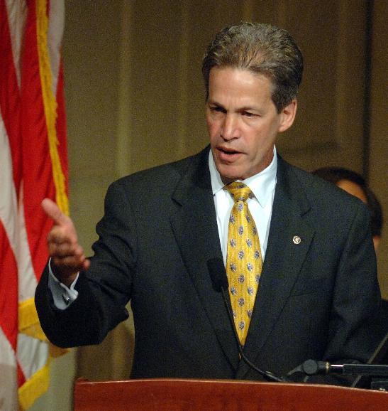 FIRST LADY LAURA BUSH SPEAKS AT BIG READ CELEBRATION: Sen. Norm Coleman, R-Minn., speaks during a celebration of the project at the Library of Congress in Washington on July 20, 2006. The Big Read was designed by the National Endowment of the Arts to encourage Americans to reconnect with great works of American literature.    (UPI Photo/Roger L. Wollenberg)