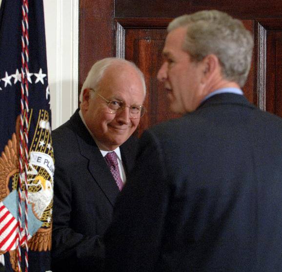 BUSH BORDER FENCE: Vice President Dick Cheney watches U.S. President George W. Bush depart after signing the Secure Fence Act of 2006 authorizing 700 miles of fencing along the U.S.-Mexico border in the Roosevelt Room of the White House on October 26, 200