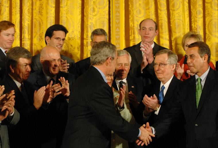 U.S. President Bush signs the Economic Stimulus Act in Washington: U.S. President George W. Bush shakes hands with members of Congress after signing H.R. 5140, the Economic Stimulus Act of 2008 in the East Room at the White House in Washington on February 13, 2008. (UPI Photo/Alexis C. Glenn)