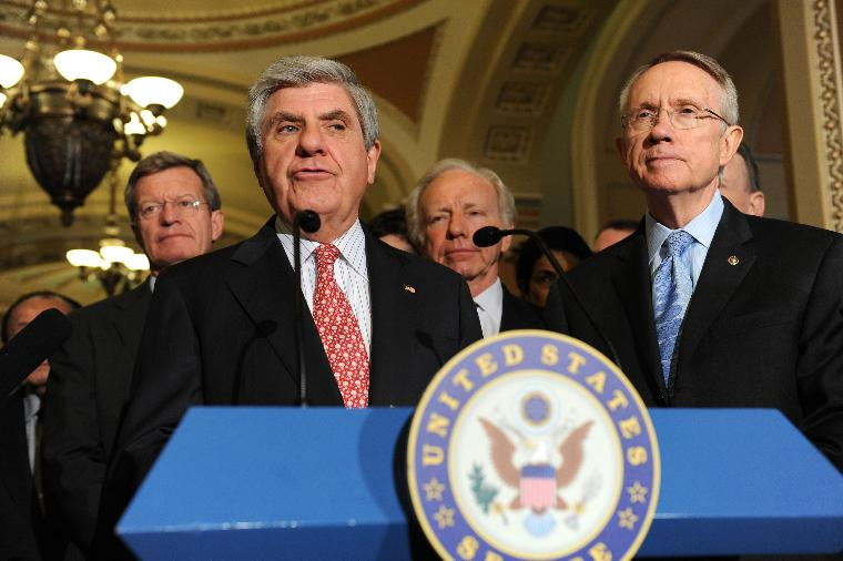 Senate and House reach agreement on the Economic Stimulus Package in Washington: Sen. Ben Nelson (D-NE) speaks alongside Senate Majority Leader Harry Reid (D-NV) (R), Sen. Max Baucus (D-MT) (2nd-L) and Sen. Joe Liberman (I-CT) after the Senate and House reached an agreement on the $789 billion economic stimulus package on Capitol Hill in Washington on February 11, 2009. The bill includes increased unemployment benefits, money for states that face budget deficits and preserves President Obama's requested tax cut. Both Houses are expected to vote on the new package in the coming days. (UPI Photo/Kevin Dietsch)