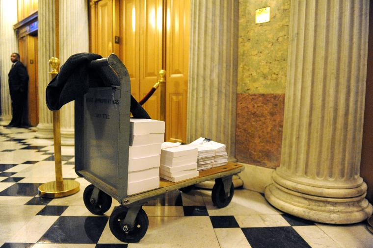 House and Senate meet to discuss the economic stimulus package in Washington: A cart containing copies of the old and new economic stimulus package is seen outside of a meeting with members of the House and Senate Appropriations Committee as they discuss the economic stimulus package on Capitol Hill in Washington on February 11, 2009. (UPI Photo/Kevin Dietsch)