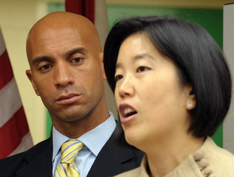 D.C. Mayor Fenty, schools chiefs, announce math test scores increases in Washington: D.C. Mayor Adrian Fenty listens as D.C. Public Schools Chancellor Michelle Rhee speaks during a news conference to discuss the District of Columbia's 2009 math scores on the National Assessment of Educational Progress at at M.C. Terrell Elementary School in Washington on October 15, 2009. The trio announced