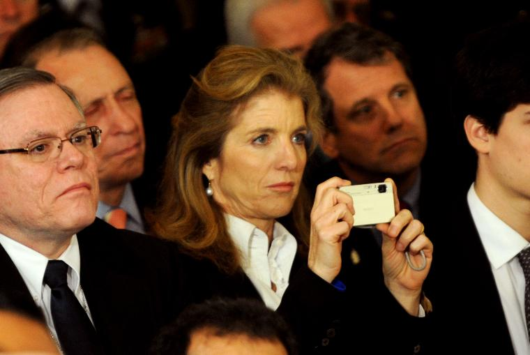 President Obama Signs Historic Health Care Bill in Washington: Caroline Kennedy, daughter of former President John F. Kennedy, takes a picture of U.S. President Barack Obama as he addresses the invited crowd for the signing of the Health Insurance Reform Bill in the East Room of the White House in Washington, DC on March 23, 2010.   The historic $938 million health care bill will guaranteed coverage for 32 million uninsured Americans and will touch nearly every American's life.   UPI/Pat Benic
