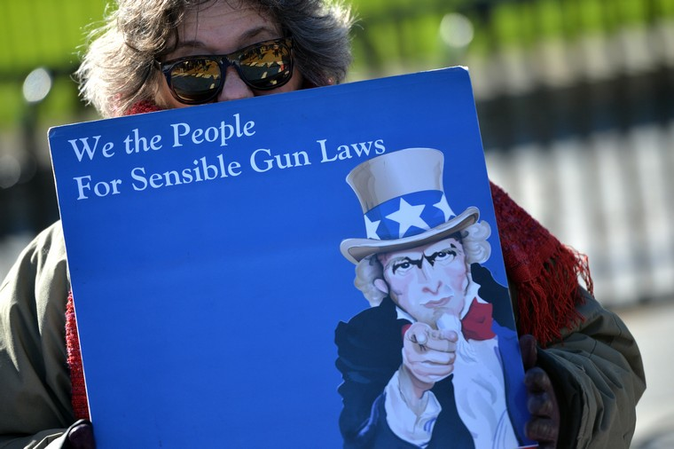 A gun control supporter participate in a protest calling on congress and the White House to straighten gun laws, in front of the White House in Washington, D.C. on January 4, 2016. President Obama is meeting today with members of his national security team to discuss an executive action on curbing gun violence. Photo by Kevin Dietsch/UPI