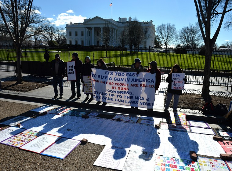 Gun control supporters participate in a protest calling on congress and the White House to straighten gun laws, in front of the White House in Washington, D.C. on January 4, 2016. President Obama is meeting today with members of his national security team to discuss an executive action on curbing gun violence. Photo by Kevin Dietsch/UPI