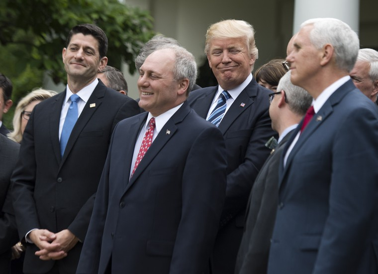 President Donald Trump (C) stands with Speaker of the House Paul Ryan, R-Wis. (L), House Majority Whip Steve Scalise, R-LA, and other Republican congress members during a press event celebrating the House passage of Republican legislation to roll back the Affordable Care Act, at the White House in Washington, D.C. on May 4, 2017. The American Health Care Act passed the House with a vote of 217-213 vote. It will next move to the Senate. Photo by Kevin Dietsch/UPI
