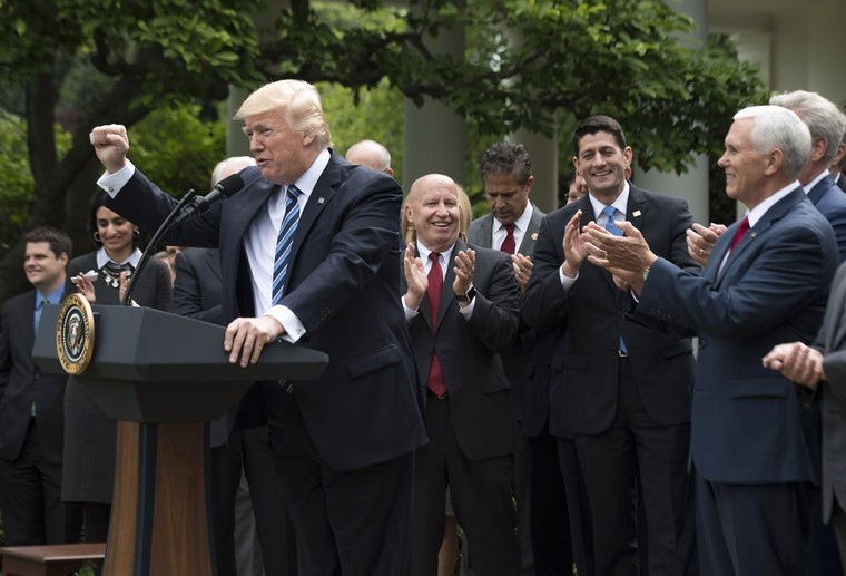 President Donald Trump, joined by Republican House leadership and members, delivers remarks during a press event celebrating the House passage of Republican legislation to roll back the Affordable Care Act, at the White House in Washington, D.C. on May 4, 2017. The American Health Care Act passed the House with a vote of 217-213 vote. It will next move to the Senate. Photo by Kevin Dietsch/UPI