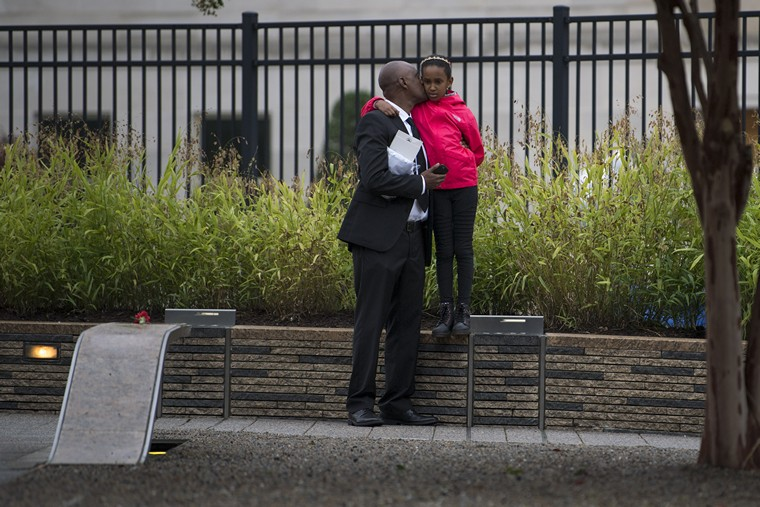 A family visits the National 9/11 Pentagon Memorial on the 17th anniversary of the terrorist attacks on the United States, at the Pentagon, Arlington, Virginia, September 11, 2018. Today the country observes the 17th anniversary of the attacks, in which four airliners were hijacked and used in suicide attacks on both the World Trade Center towers, the Pentagon and the fourth crashing in Shanksville, Pennsylvania, 2,996 people were killed. Photo by Kevin Dietsch/UPI