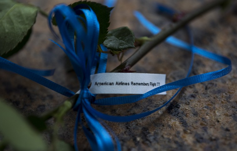A note of remembrance for flight 77, that was crashed into the Pentagon, is seen at the National 9/11 Pentagon Memorial on the 17th anniversary of the terrorist attacks on the United States, at the Pentagon, Arlington, Virginia, September 11, 2018. Today the country observes the 17th anniversary of the attacks, in which four airliners were hijacked and used in suicide attacks on both the World Trade Center towers, the Pentagon and the fourth crashing in Shanksville, Pennsylvania, 2,996 people were killed. Photo by Kevin Dietsch/UPI