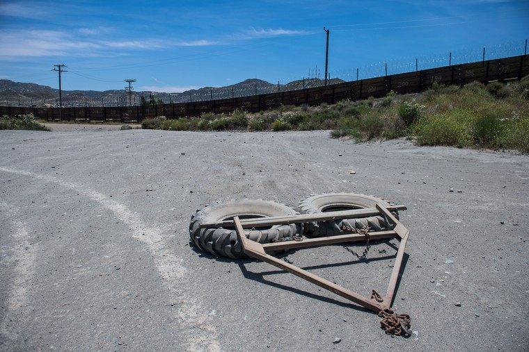 Tires used to clean the road by U.S. Border Patrol agents are seen near a section of border fence on the U.S. - Mexico border in Tecate, California on June 10, 2019. Photo by Kevin Dietsch/UPI