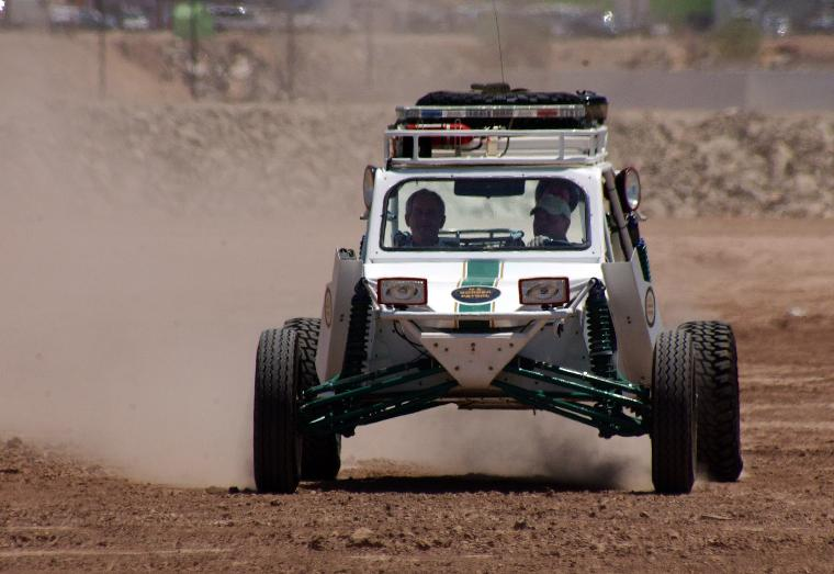 PRESIDENT BUSH VISITS THE BORDER TO PROMOTE IMMIGRATION REFORM: President Bush rides shotgun in a sand rail, also known as a dune buggy, that is used by the Border Patrol with driver Borstar Agent Rocky Kittle in San Luis, AZ on May 18, 2006. The President visited Yuma, Arizona Thursday and rode from there to the border town of San Luis, Arizona where he road in the sand rail. The wall behind the chainlink fence in the background is the Mexican border. (UPI Photo/Terry Ketron/Pool/Yuma Sun)