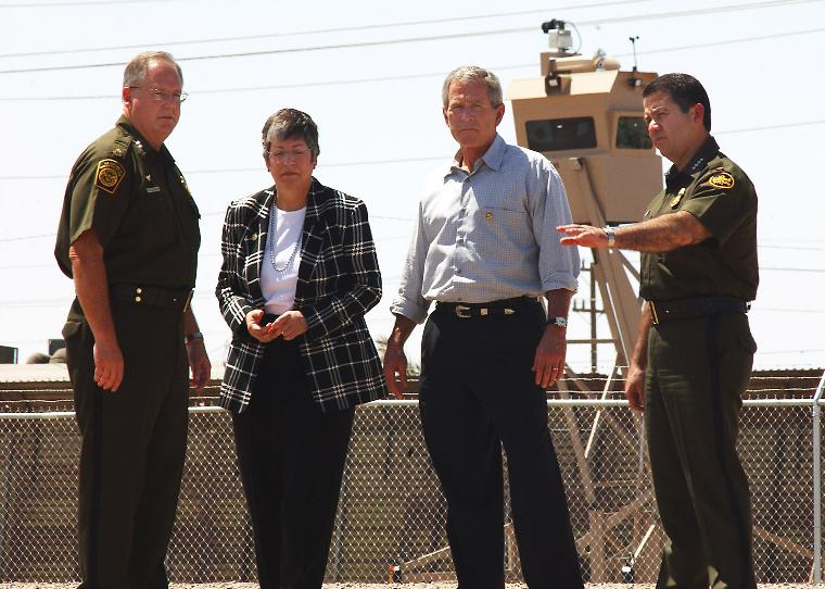 PRESIDENT BUSH VISITS THE BORDER TO PROMOTE IMMIGRATION REFORM: From left, Yuma Sector Border Patrol Chief Ronald Colburn, Arizona Governor Janet Napolitano, President Bush and Head of the Border Patrol, David Aguilar stand in front of a