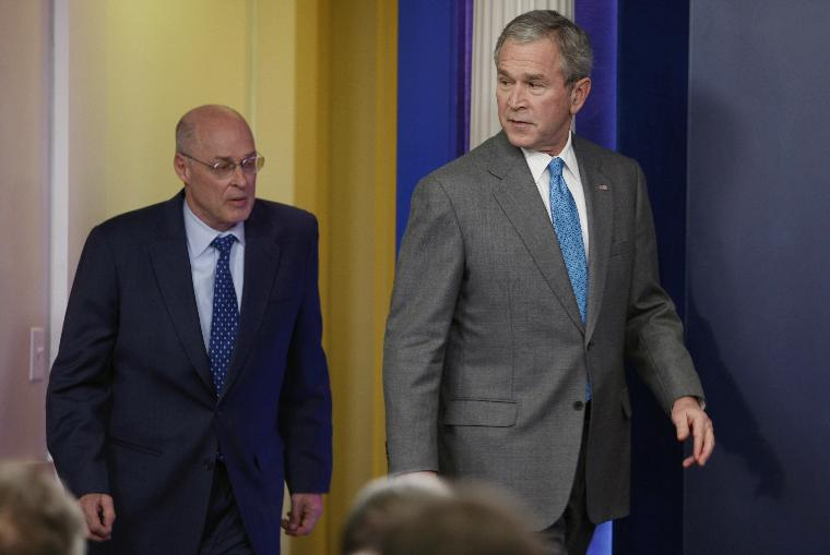 US President George W. Bush makes a statement on the economy from the White House in Washington, D.C.: U.S. President George W. Bush looks back at U.S. Secretary of Treasury Henry Paulson as they enter the briefing room to make a statement on the economic stimulus package passed by the U.S. Congress today during a briefing at the White House in Washington, on January 24, 2008.  Congressional leaders and the White House reached a tentative agreement on an economic stimulus package of roughly $150 billion that would pay stipends of $300 to $1,200 per family and provide tax incentives for businesses to encourage spending.   (UPI Photo/Shawn Thew/Pool)