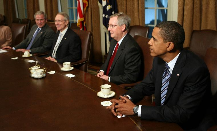 Bush holds meeting with Congressional leaders on financial bailout in Washington: U.S. President George W. Bush prepares to host a meeting with Republican and Democratic Congressional leaders to discuss the current economic crises in the Cabinet Room of the White House on September 25, 2008. From left are Bush, Senate Majority Leader Harry Reid, D-NV, Senate Minority Leader Mitch McConnell, R-KY, and Democratic Presidential Nominee Sen. Barack Obama, IL. The administration and Congress are nearing a deal on an economic bailout package.   (UPI Photo/Kristoffer Tripplaar/POOL)
