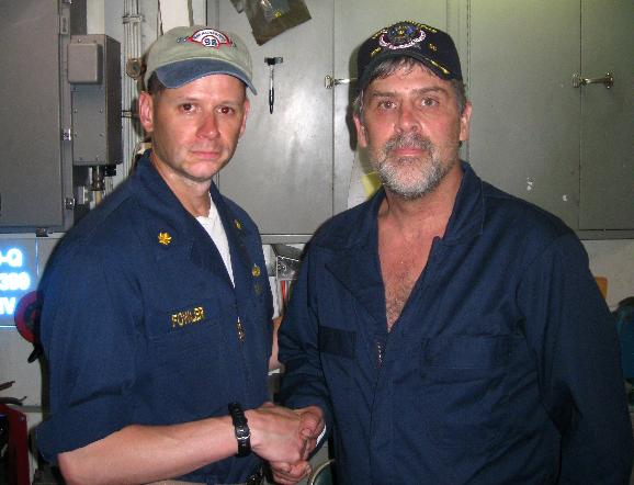 Maersk-Alabama Capt. Phillips rescued from pirates by U.S. Navy: Maersk-Alabama cargo ship captain Richard Phillips (R), stands alongside Lt. Cmdr. David Fowler, executive officer of USS Bainbridge (DDG 96), after U.S. Navy forces rescued Phillips from pirate captivity, off the coast of Somalia, April 12, 2009. Captain Phillips was rescued following a firefight that killed three of the four Somali pirates who had been holding him for five days in a lifeboat off the coast of Africa. (UPI Photo/U.S. Navy)