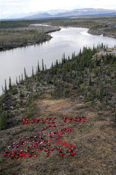 Native peoples send message to Save the Arctic in Alaska: Arctic native peoples gather on the tundra in the Arctic National Wildlife Refuge calling for permanent protection of the refuge and urgent action on climate change near Arctic Village, Alaska, on May 30, 2009.  The human banner reads