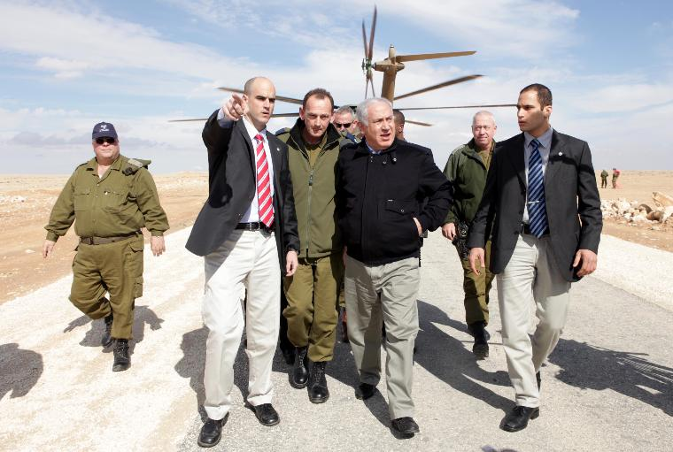 Isralie PM Netanyahu surveys Egypt-Israel border wall construction: Prime Minister Biniamin Netanyahu (second right) lands near the Har Sagi IDF base near the Egyptian border where he was briefed by Israeli Defense Force (IDF) Southern Command officers on the construction of a fence along Israel's border with Egypt to prevent the infiltration of terrorists, smugglers and migrant workers on January 21, 2010.  UPI/Ariel Jerozolimski/POOL
