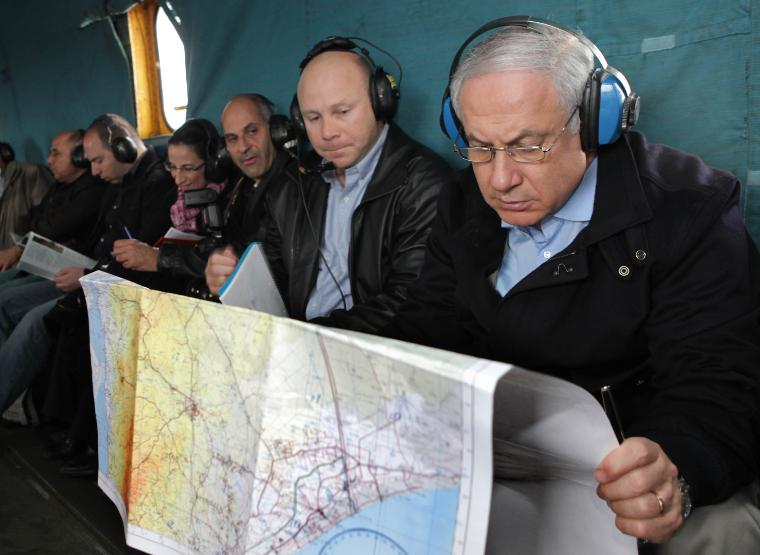 Isralie PM Netanyahu surveys Egypt-Israel border wall construction: Prime Minister Benjamin Netanyahu looks at the Israel-Egypt border area in a map during a flight in a military helicopter to the Egyptian border where he was briefed by Israeli Defense Force (IDF) Southern Command officers on the construction of a fence along Israel's border with Egypt to prevent the infiltration of terrorists, smugglers and migrant workers on January 21, 2010.  UPI/Ariel Jerozolimski/POOL