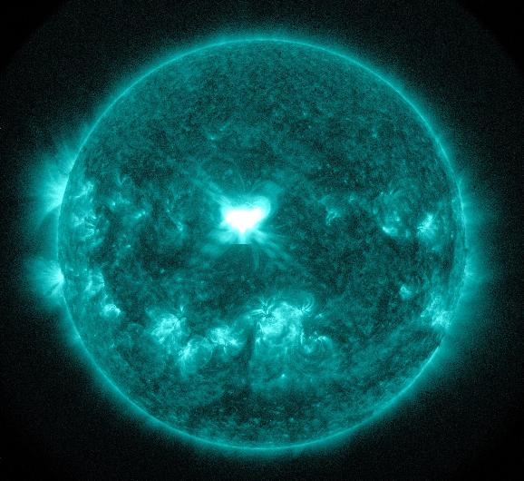 Solar Flare Captured by NASA: An X1.6 class solar flare flashes in the middle of the sun on September 10, 2014. This image was captured by NASA's Solar Dynamics Observatory and shows light in the 131 Angstrom wavelength, which is typically colorized in teal.  Solar flares are powerful bursts of radiation. Harmful radiation from a flare cannot pass through Earth's atmosphere to physically affect humans on the ground.  However -- when intense enough -- they can disturb the atmosphere in the layer where GPS and communications signals travel.   UPI.