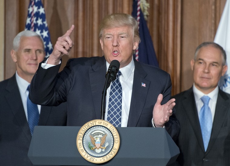 United States President Donald J. Trump makes remarks prior to signing an Energy Independence Executive Order at the Environmental Protection Agency (EPA) Headquarters in Washington, DC on March 28, 2017.  The order reverses the Obama-era climate change policies.      Pool photo by Ron Sachs / UPI