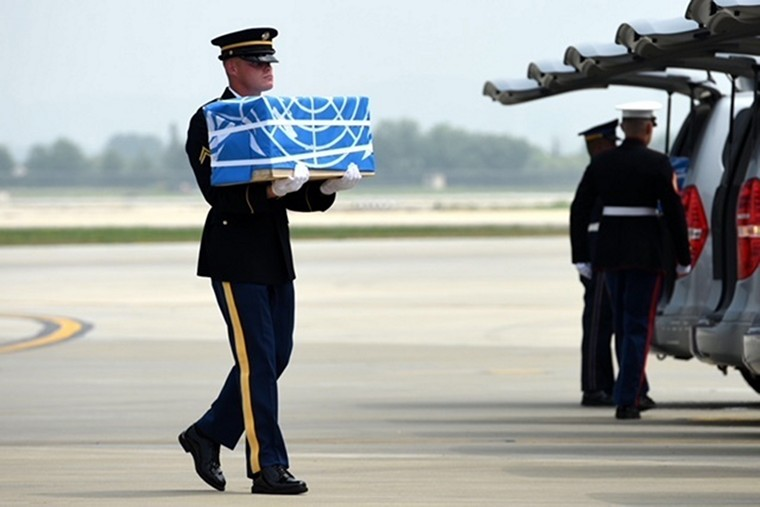 A United Nations Honor Guard member carries the reported remains of U.S. service members, returned by the Democratic People's Republic of Korea, during a dignified return ceremony at Osan Air Base, Republic of Korea, on July 27, 2018. Members of the command and the Osan community were on hand at the arrival ceremony. Photo by SrA Kelsey Tucker/U.S. Air Force/UPI