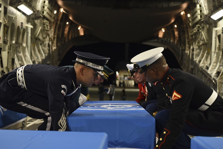 Members of the United Nations Command Honor Guard move dignified transfer cases from one C-17 Globemaster III to another during a repatriation ceremony at Osan Air Base, Republic of Korea, on August 1, 2018. The UNC repatriated 55 cases of remains returned by the Democratic People's Republic of Korea. Photo by A1C Ilyana Escalona/U.S. Air Force/UPI